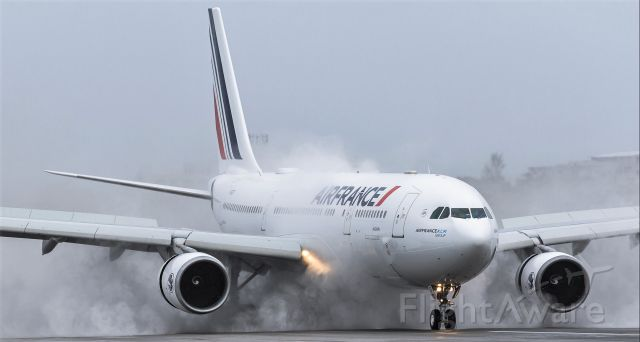 Airbus A330-200 (F-GZCF) - Air France A330-200 Avignon F-GZCF applying positive breaks after landing on St Maarten during inclement weather from tropical storm Laura. 22/08/2020