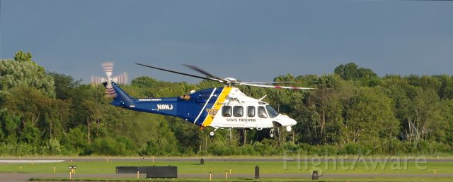 BELL-AGUSTA AB-139 (N9NJ) - MORRISTOWN, NEW JERSEY, USA-AUGUST 09, 2019: A New Jersey State Police Helicopter, registration number N9NJ, is seen taking off from Morristown Municipal Airport shortly after the arrival of President Donald Trump on board Air Force One. The NJSP helped provide security for the President and Air Force One.