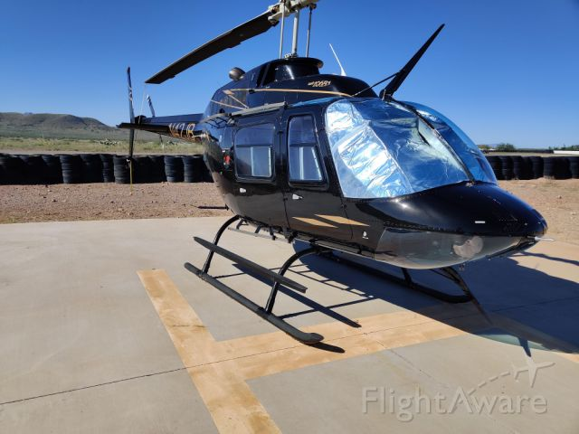 Bell JetRanger (N42JB) - JB's Bell 206 on the ground at Inde Motorsports Ranch.  Homebase: KTUS.