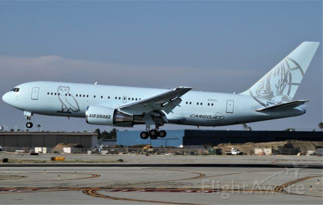 BOEING 767-200 (N767CJ) - Elan Express 1086 (Air Drake) B767-200 landing at Long Beach Airport after a short flight from Lax.