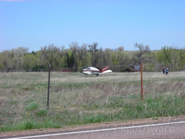Beechcraft 35 Bonanza (N8SM) - damaged plane in field ... you can see that the left wing is missing