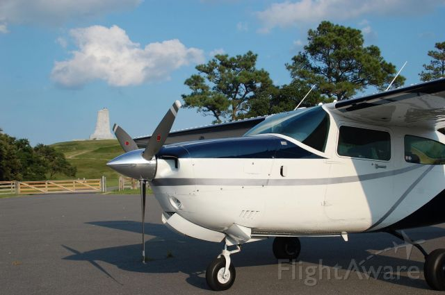 Cessna Centurion (N610KC) - This workhorse (and it's pilot and camera operator) took a short detour to land at KFFA - Kitty Hawk, North Carolina.  It was just recently painted and was a beautiful and fun aircraft to fly.