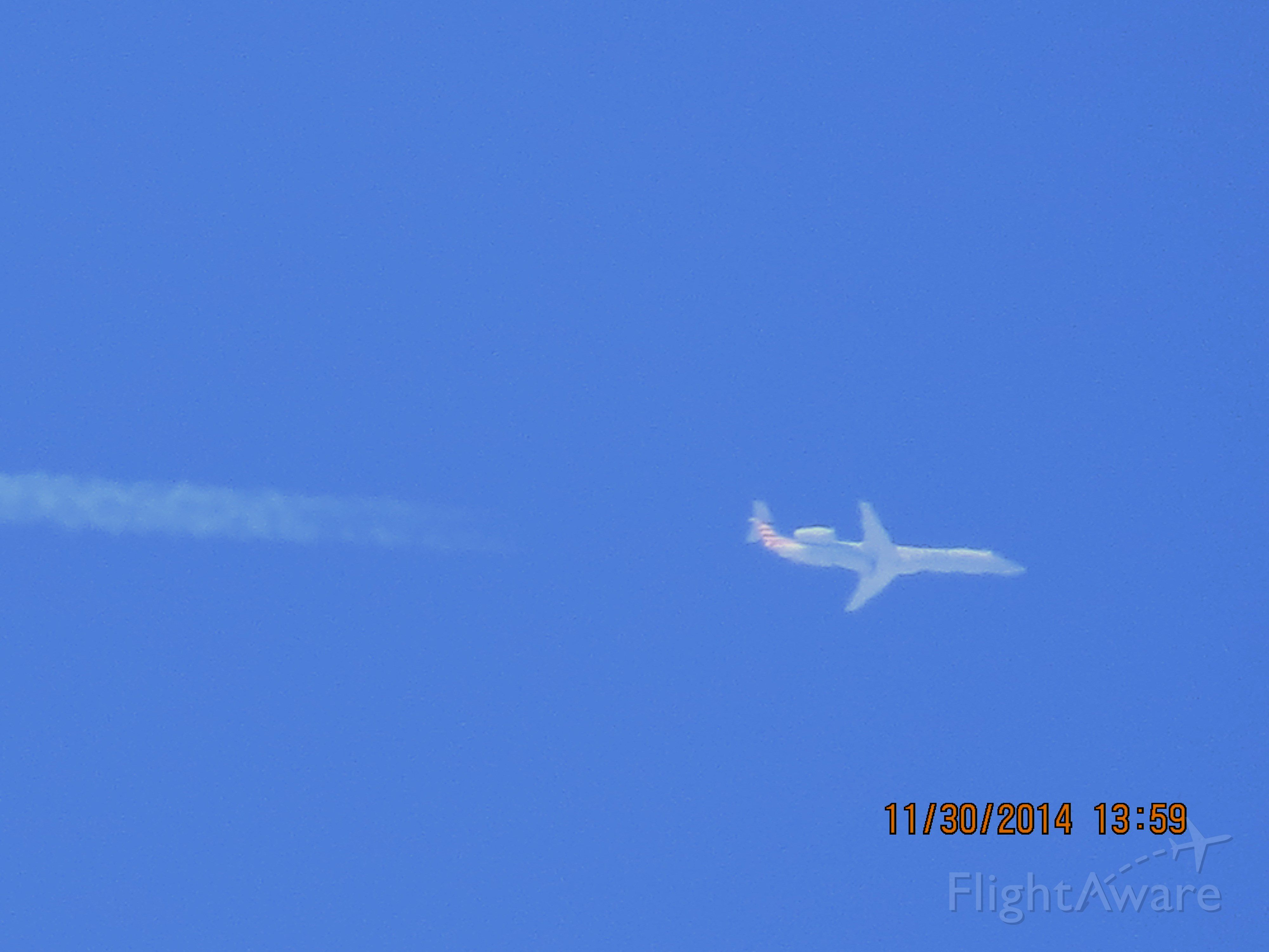 Embraer ERJ-145 (N928AE) - American Eagle flight 3242 from OKC to ORD over Southeastern Kansas at 35,000 feet.