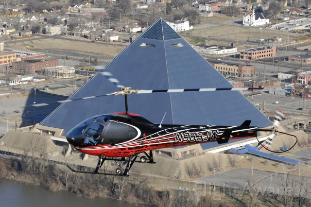 N9835JW — - Test flight by the owner on his new purchase.  This Enstrom 280 FX is photographed flying past the Memphis Pyramid, along the Mississippi River.