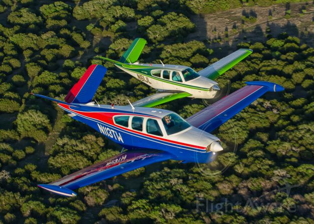 Beechcraft 35 Bonanza (N113TW) - N113TW and N61JL in tight formation...Photography by Glenn Watson of Mach Point One Aviation