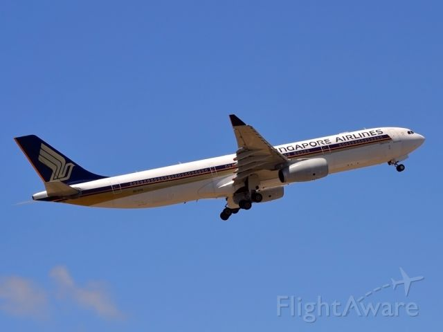 Airbus A330-300 (9V-STQ) - Getting airborne off runway 23 and heading home to Singapore. Monday 19th Dec. 2011