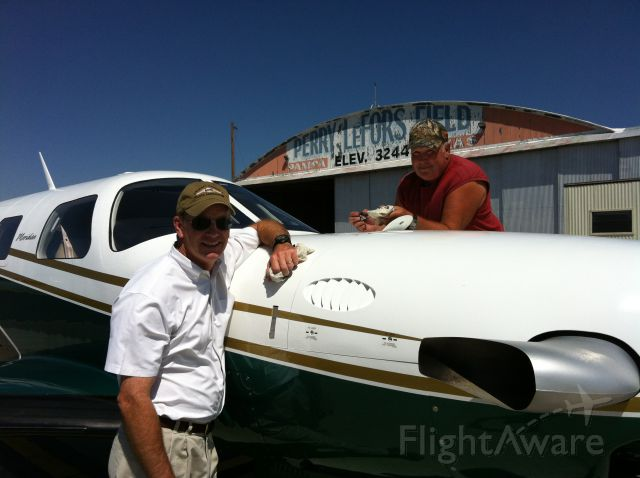 Piper Malibu Meridian (N945LA) - Good old Ron Unruh checks the oil in the Green Hornet.