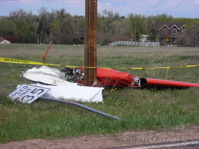 Beechcraft 35 Bonanza (N8SM) - wing removed from aircraft during accident