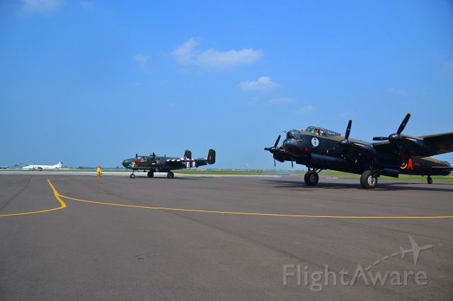 """Avro 683 Lancaster (VRA) - A """"Lancaster Bomber and a B25 Mitchell Bomber"""" getting ready to do a formation flyover CYQG."""