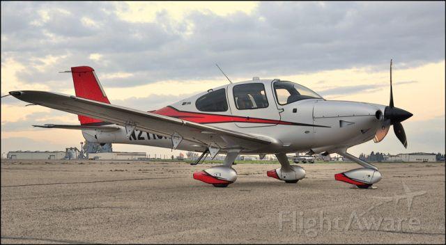 Cirrus SR22 Turbo (N211CK) - Sitting on the ramp at the Merced Regional Airport