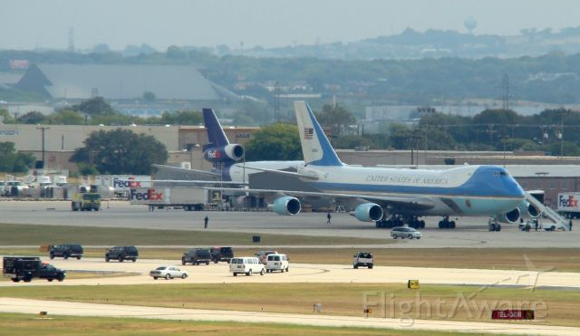 Boeing 747-200 (N28000) - Oct 6,08. Motorcade arriving. Shot from the parking garage, San Antonio Int