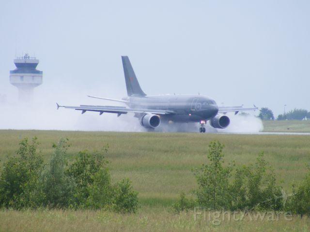 Airbus A310 (C15003) - cc-150 landing just after a down pour.