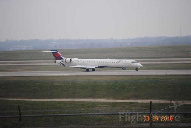 Canadair Regional Jet CRJ-900 (N691CA) - Just landed with Reverse thrust.