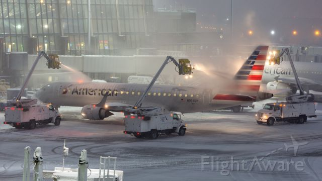 Embraer ERJ-190 (N954UW) - Deicing in full swing as the first snow of the season arrives to Boston
