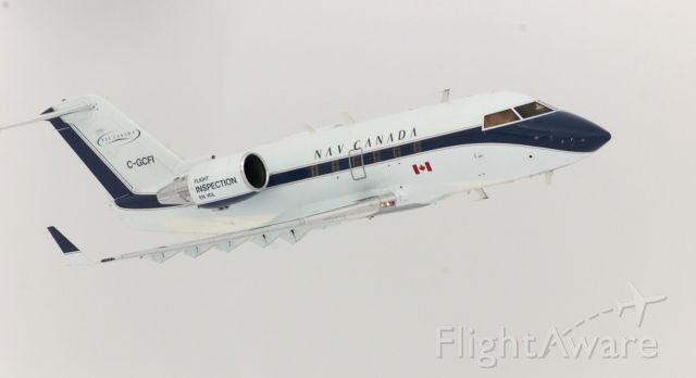 Canadair Challenger (C-GCFI) - A Nav Canada Inspection airplane flying low over Calgary International Airport.