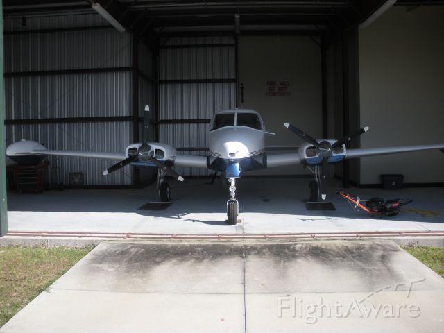 Cessna 310 (N241AJ) - In hangar at X35