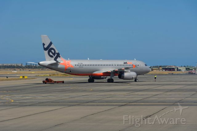 Airbus A320 (VH-VQH) - Tug away, almost ready for departure