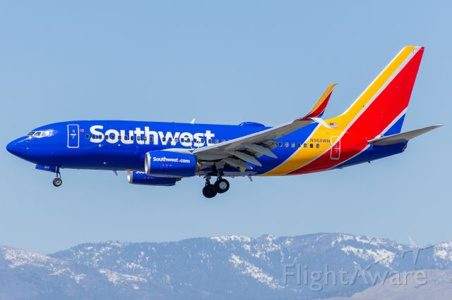 Boeing 737-700 (N968WN) - Southwest 581 passing over Mill St. on arrival from Houston-Hobby