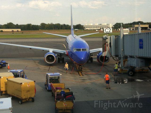 "Boeing 737-700 (N222WN) - Came into gate C2 ""Florida One"" (N945WN) pushed back."