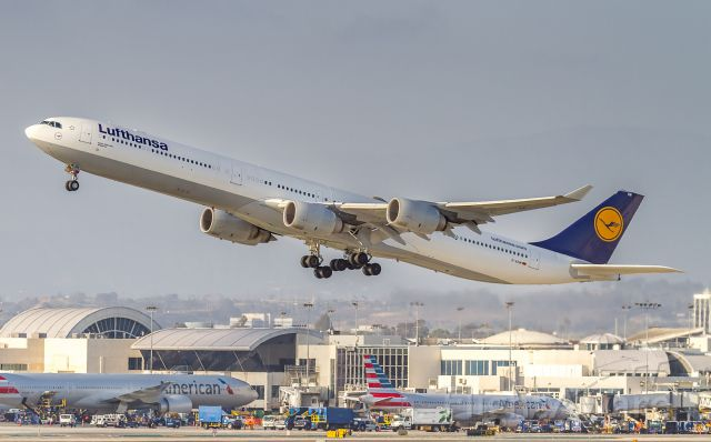 Airbus A340-600 (D-AIHM) - DLH453 climbs off runway 25R and heads back to Munich