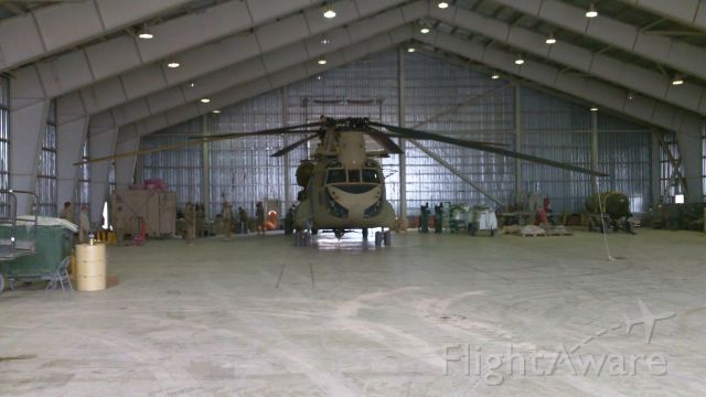 — — - US Army CH-47F about to undergo a C-17 tear-down prior to shipment back to the US.