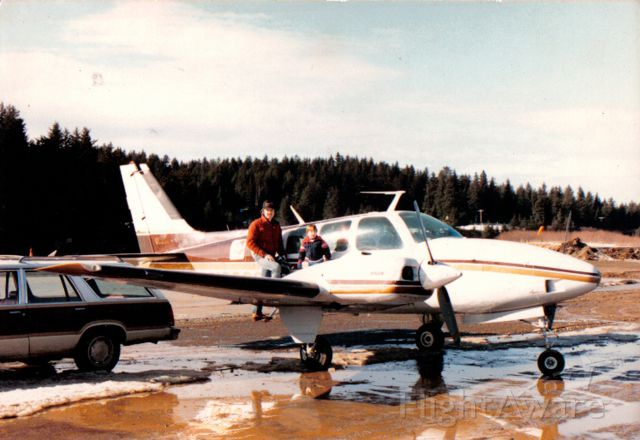 N830CC — - Mike and Joey King , Uncle Butch's Baron in the early 80s, Seldovia, Alaska