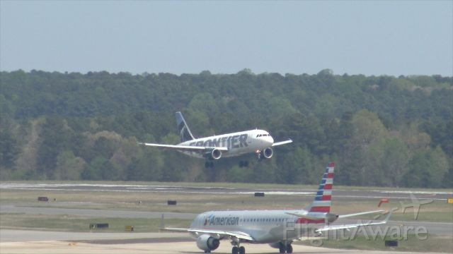 Airbus A320 (N216FR) - Frontier Airlines flight 907, arriving from Trenton Mercer. Taken from the hourly parking deck at RDU