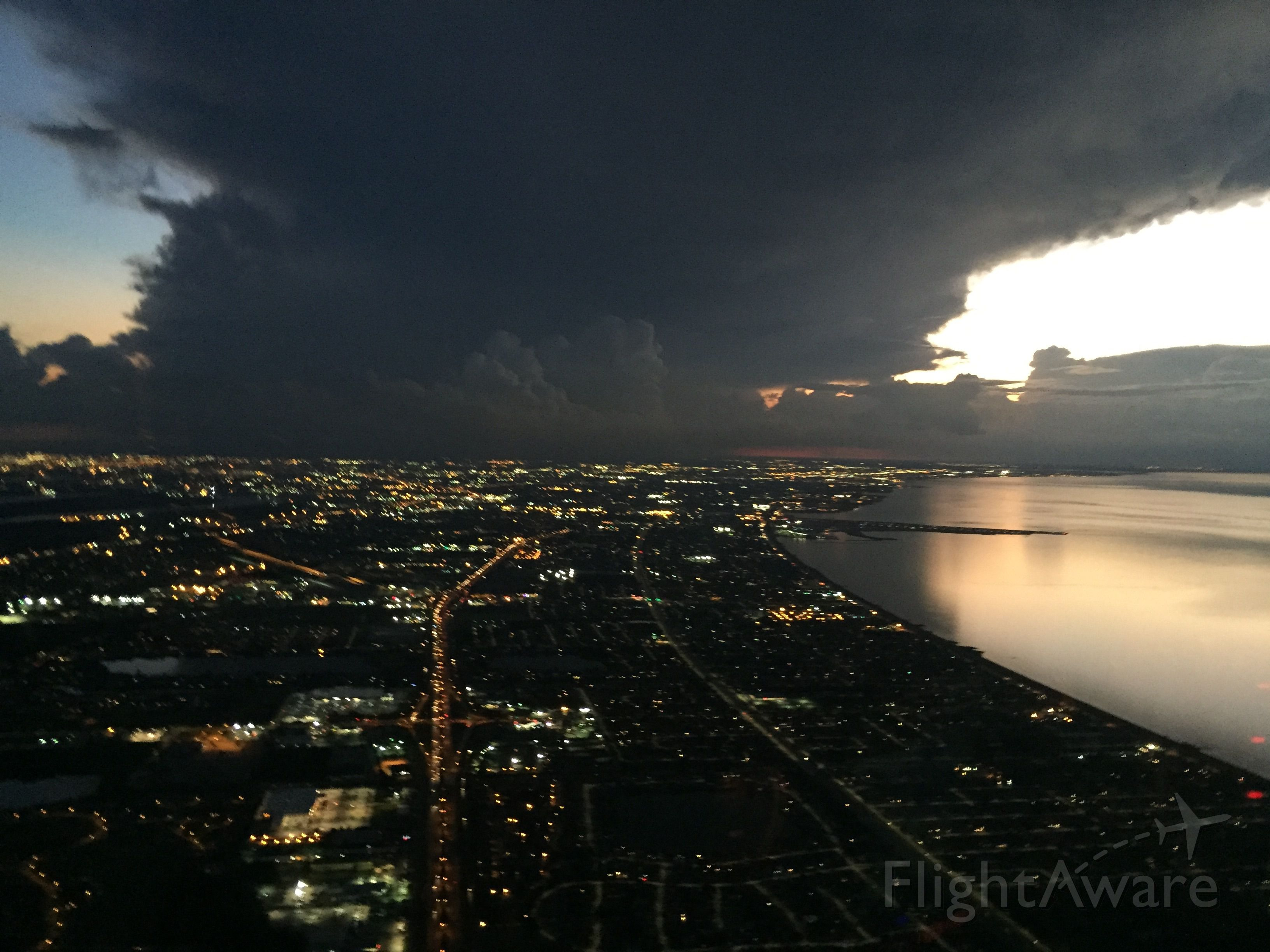 Cessna Skyhawk (N1417U) - Dusk return to New Orleans Lakefront with storms in the distance.