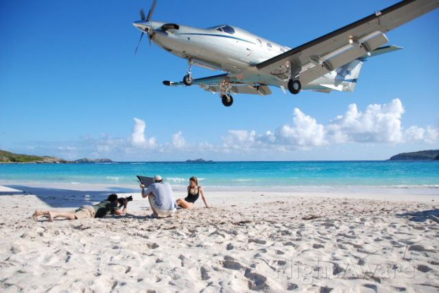 Pilatus PC-12 — - A Tradewind Aviation PC-12 on short final for runway 28 at St Barths (TFFJ) in the French West Indies. Tradewind operates a fleet of Cessna Caravans and Pilatus PC-12s from San Juan (TJSJ) with premium scheduled daily service to St. Barths.