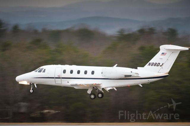 Cessna Citation III (N88DJ) - 29_Jan_2010. Arriving on 24 as light snow & the Arctic blast rolls into Hickory.