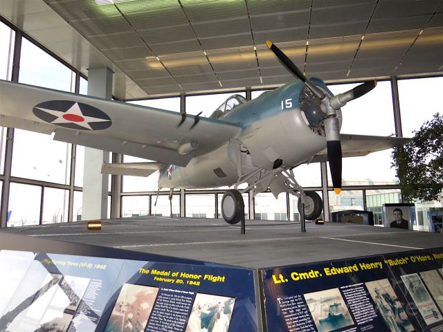 """N12320 — - Grumman F4F-3 Wildcat, flown by Lt. Cmdr. Edward Henry """"Butch"""" OHare, on permanent display at Chicago OHare International Airport Terminal Two."""