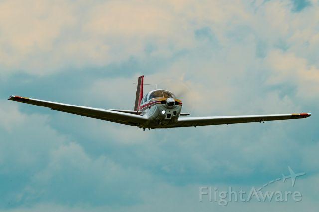 N5599Q — - 1965 Mooney M20C N5599Q taking off before a storm at 8N1 (Grimes Field).