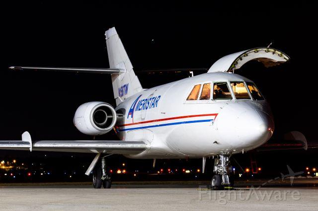 Dassault Falcon 20 (N158TW) - Ameristar Falcon 20 unloading on a brisk and windy night!
