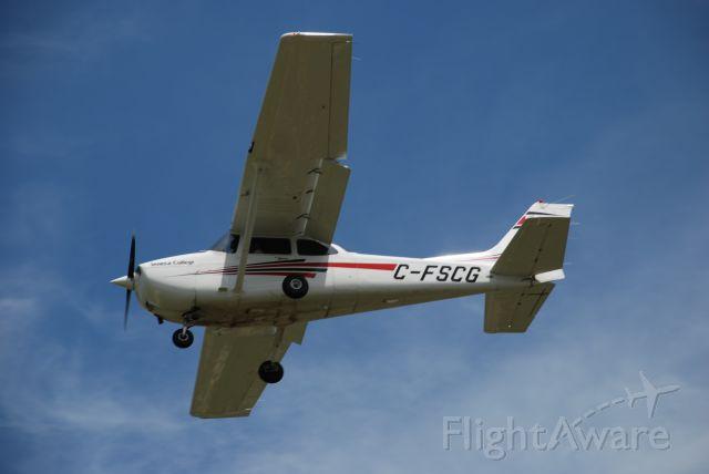 Cessna Skyhawk (C-FSCG) - Seneca College (Flight School) Cessna 172S landing at Buttonville Airport (Toronto) July 4/08