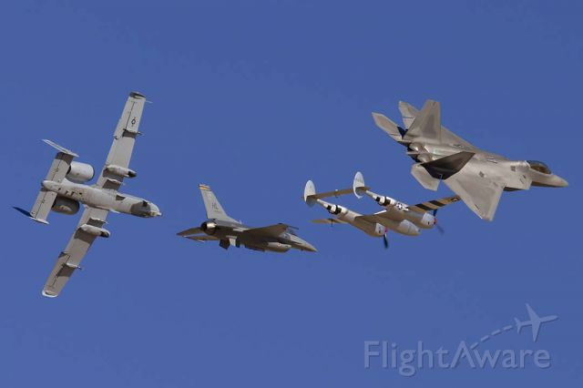 Lockheed F-22 Raptor (91-4008) - US Air Force Heritage flight: Lockheed-Martin F-22A Engineering, Manufacture, and Development (EMD) Raptor 91-4008, Lockheed P-38J Lightning N7723C, Lockheed-Martin F-16D Fighting Falcon 80-0553, and Fairchild-Republic OA-10A Thunderbolt II 80-0279 at Edwards Air Force Base on October 17, 2009.