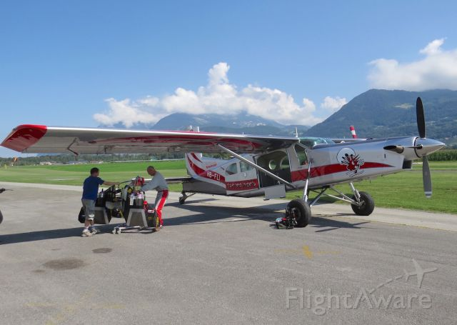 """Pilatus PC-6B Turbo-Porter (HB-FLI) - Bex Aerodrome in the Valley of the Rhone in Switzerland is the home base of Yves """"Jetman"""" Rossy. Here he is seen getting his jetwing onto the Pilatus Porter for a practice jump."""