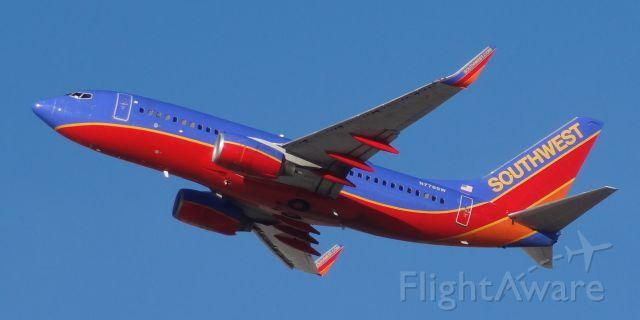 Boeing 737-700 (N778SW) - Taken on December 31, 2013. This Boeing 737-700 was taking off from runway 1 at Las Vegas McCarran Airport.