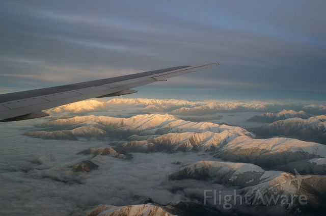 ZK-NCG — - Sunrise over the Southern Alps of New Zealand