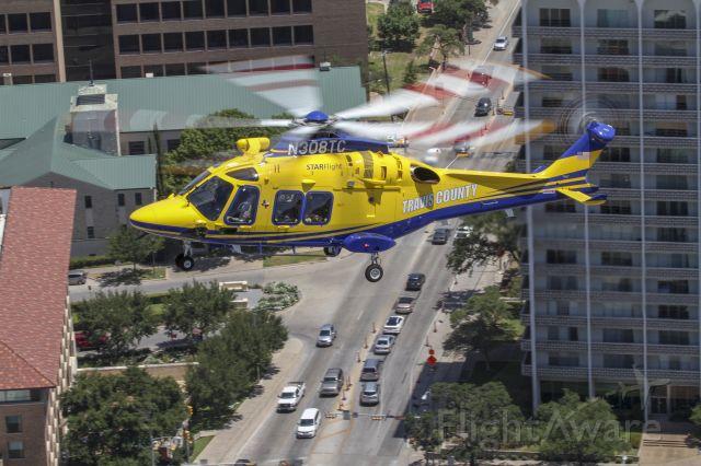 N308TC — - STARFlight AW169 preparing to land at Dell Seton Hospital downtown Austin.