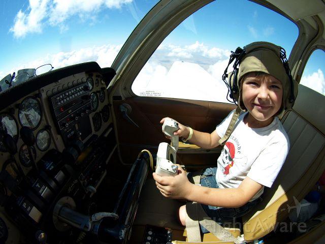 "Beechcraft 55 Baron (N624LJ) - Maximilian, Piloting ""LJ"" at 8 years old."