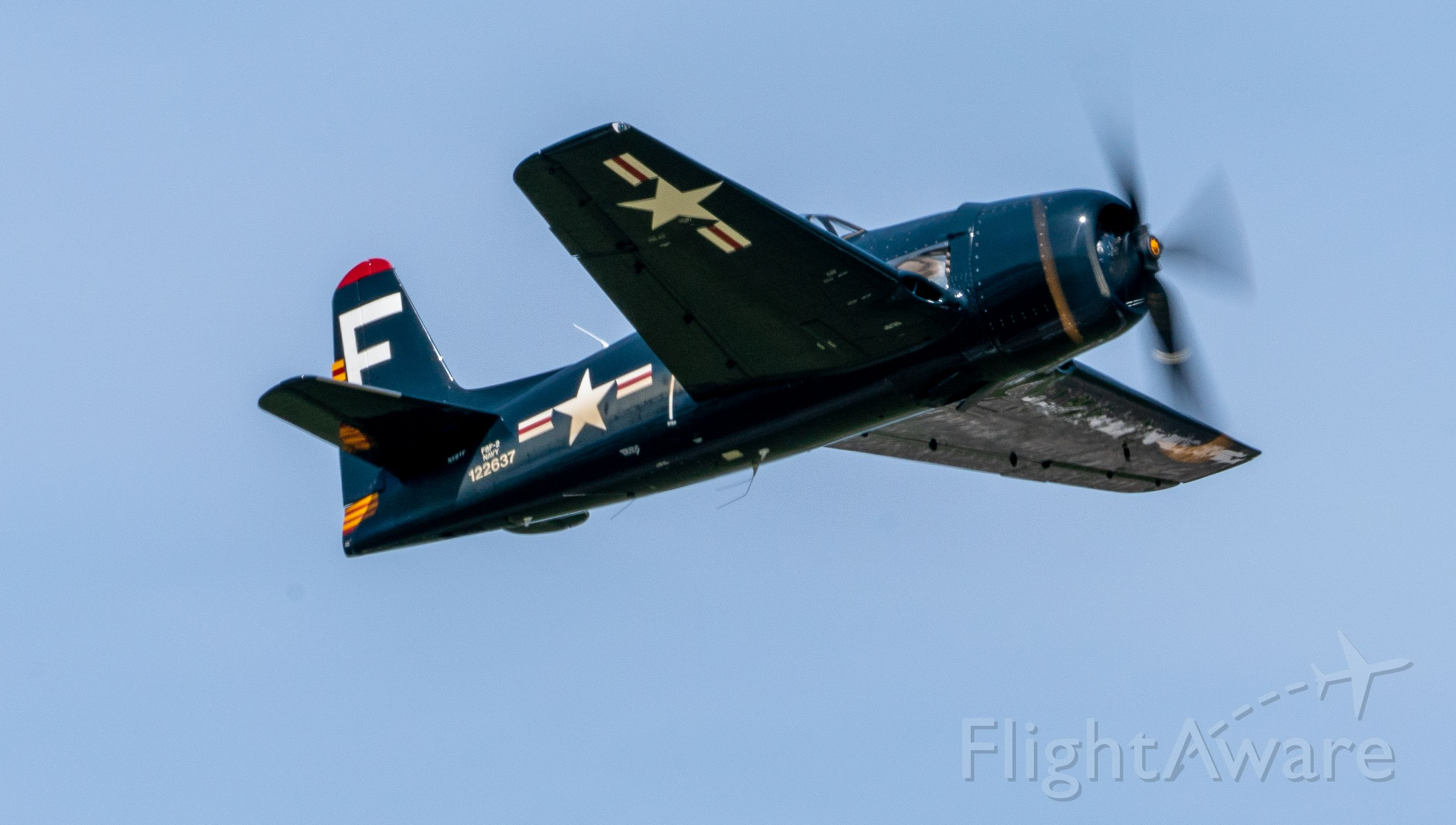 12-2637 — - A privately owned F8F-2 Bearcat departs KEFD on 4/2/2021