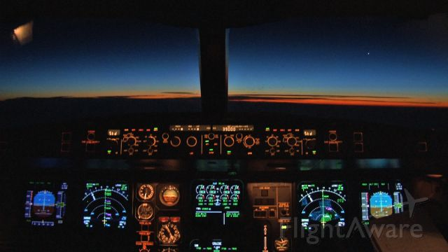 Airbus A340-300 (AP-EDF) - Sunrise in the cockpit of Airblues Airbus A340-300 en route to Islamabad from Manchester