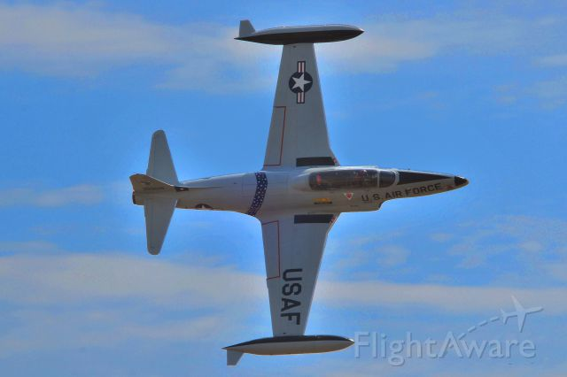 Lockheed T-33 Shooting Star (N21306) - U.S.Air Force T-33 in a slow roll for a photo op.