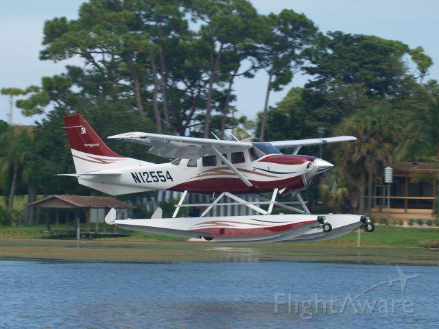 Cessna 206 Stationair (N12554) - In Flight, Lantana, FL