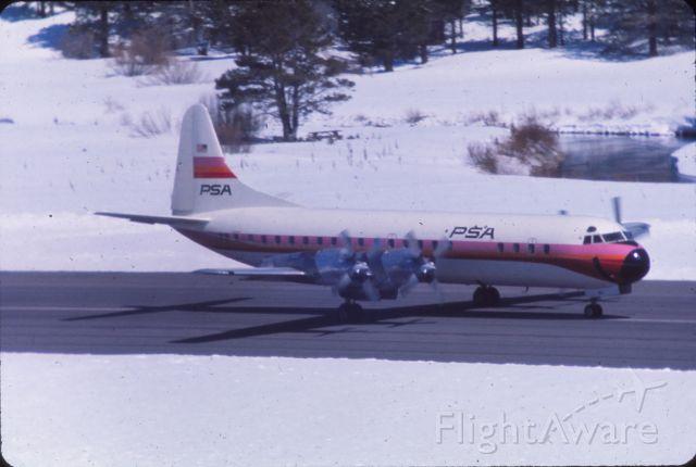 Lockheed L-188 Electra — - 1975...  PSA Electra landing So Lake Tahoe
