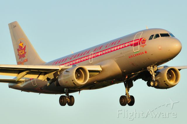 Airbus A319 (C-FZUH) - Arriving from YEG/CYEG on Rwy 25 at sunset.