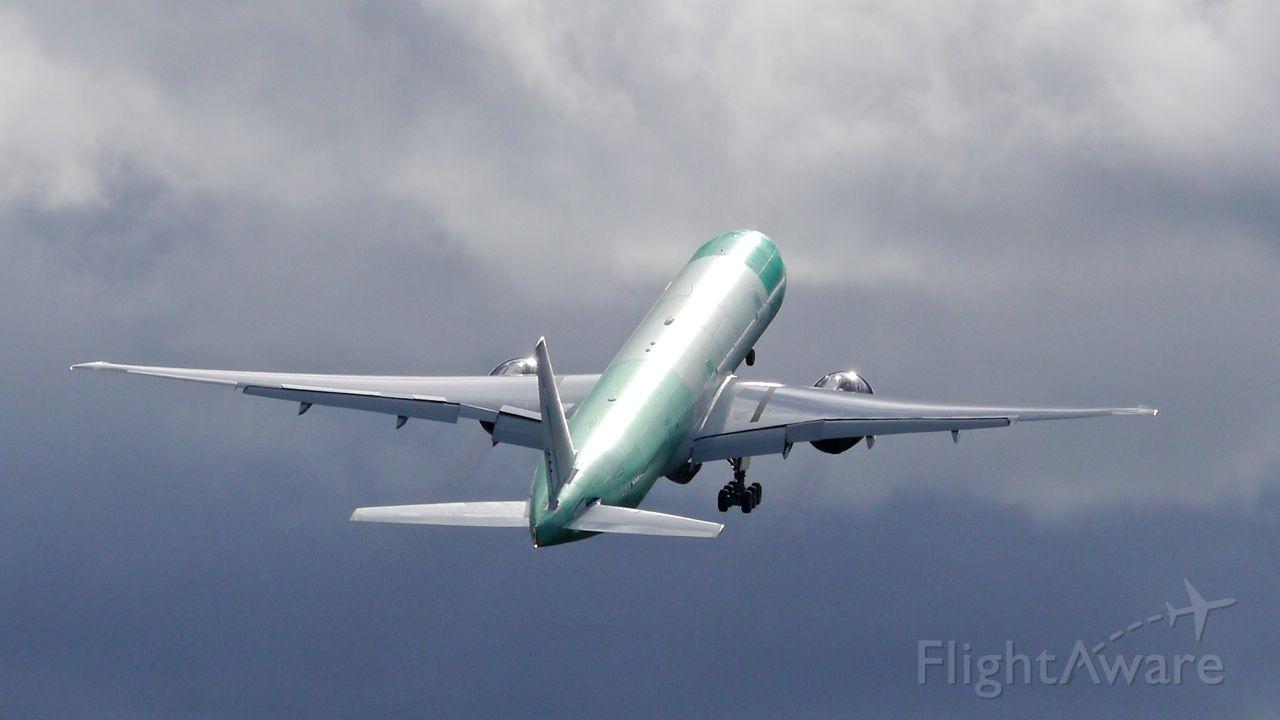 BOEING 777-300 (VQ-BQM) - BOE344 on rotation from Rwy 16R beginning its B1 flight on 2/18/16. (ln 1381 / cn 41694).