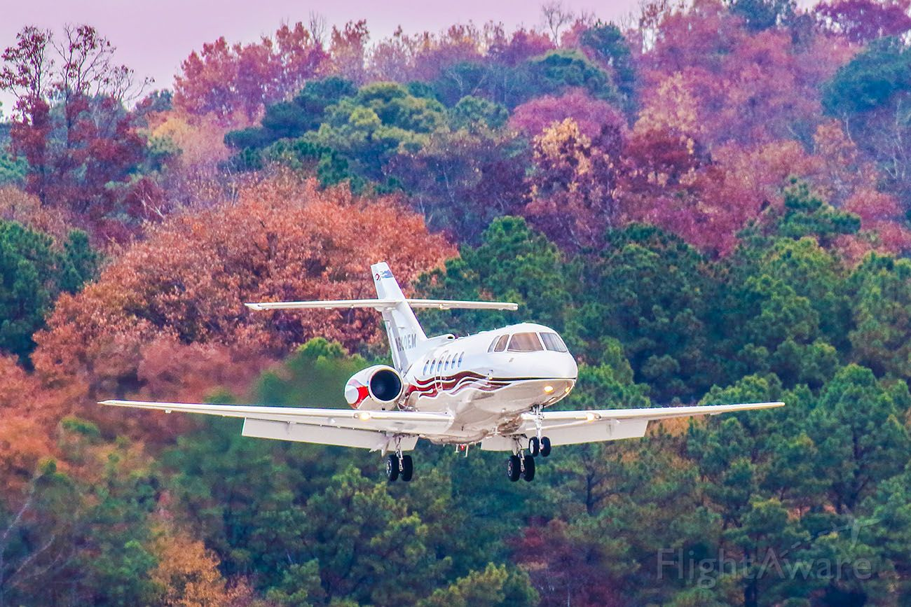 Raytheon Hawker 800 (N800EM) - On an early evening at Atlanta's PDK airport there wasn't much traffic, then I saw a jet inbound. I was using my Canon 600mm lens and waited and waited until the timing was right and I got this amazing colorful image. Not only were the leaves in full color, but this jet has a crazy cool flame paint job. My camera settings were 1/1000 shutter, F4, ISO 800. Please check out my other aviation photography. Votes and positive comments are always appreciated.