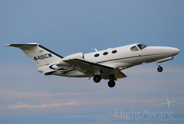 Cessna Citation Mustang (N416CM) - Departure off RWY24 at KACK. Notice person snapping their own pictures.