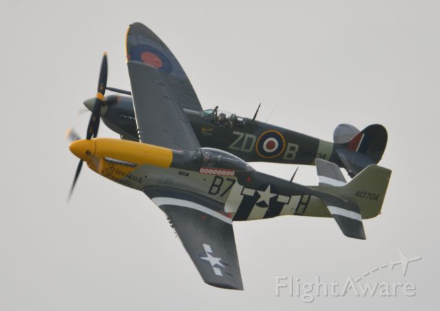 MULTIPLE — - P51D Ferocious Frankie and Spitfire Mk9 MH434 performing at Goodwood on 11 Sepetmber 2015